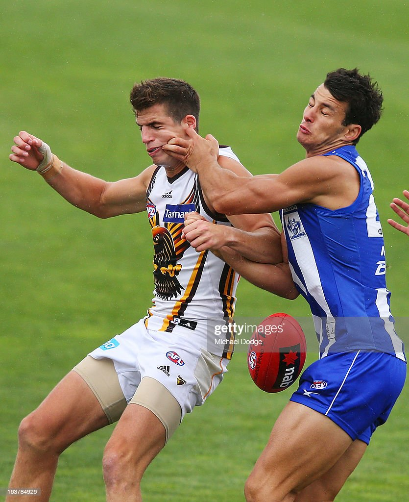 Ben Stratton (L) of the Hawks contests for the ball against Robbie Tarrant of the Kangaroos during the AFL NAB Cup match between the North Melbourne Kangaroos and the Hawthorn Hawks at Highgate Recreational Reserve on March 16, 2013 in Craigieburn, Australia.