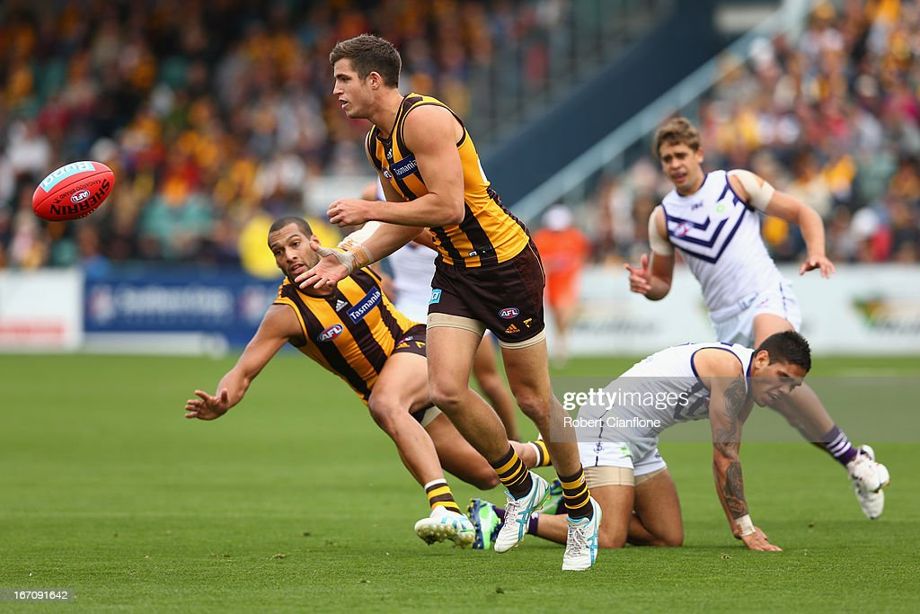 Ben Stratton of the Hawks handballs during the round four AFL match between the Hawthorn Hawks and the Fremantle Dockers at Aurora Stadium on April 20, 2013 in Launceston, Australia.