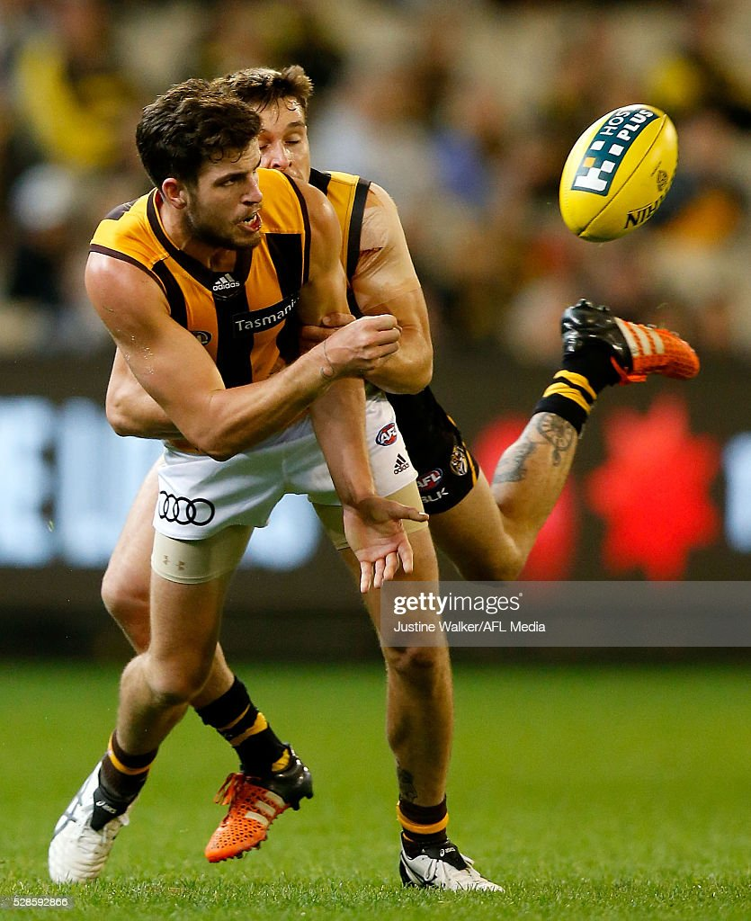 Ben Stratton of the Hawks is tackled during the 2016 AFL Round 07 match between the Richmond Tigers and the Hawthorn Hawks at the Melbourne Cricket Ground, Melbourne on May 6, 2016.