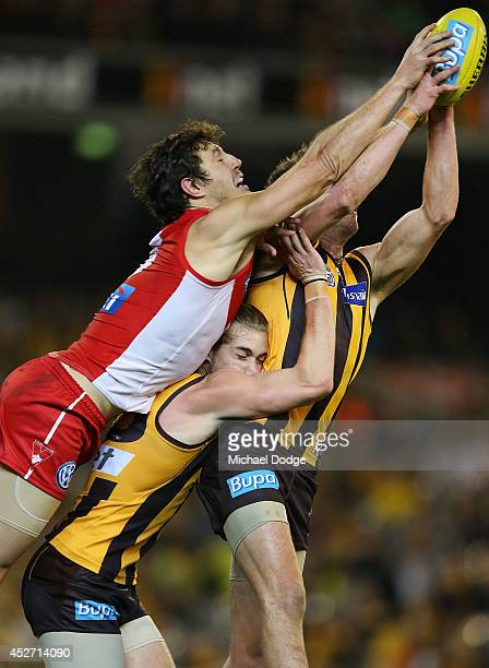 Ben Stratton of the Hawks marks the ball against Kurt Tippett of the Swans during the round 18 AFL match between the Hawthorn Hawks and the Sydney...