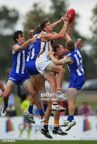 Ben Stratton of the Hawks marks the ball during the AFL NAB Cup match between the North Melbourne Kangaroos and the Hawthorn Hawks at Highgate...