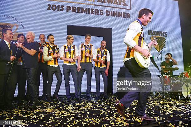 Ben Stratton plays guitar with Daryl Braithwaite during the Hawthorn Hawks AFL Grand Final dinner at Crown Palladium on October 3 2015 in Melbourne...