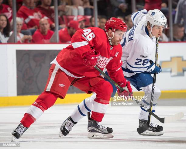 Ben Street of the Detroit Red Wings battles for position with Kasperi Kapanen of the Toronto Maple Leafs during an NHL game at Joe Louis Arena on...