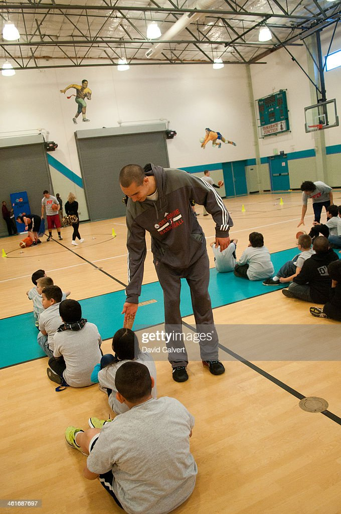 Ben Strong of the Delaware 87ers works with kids at the Boys & Girls Club of the Truckee Meadows during the NBA D-League FIT clinic part of the 2014 NBA D-League Showcase on January 7, 2014 in Reno, Nevada.