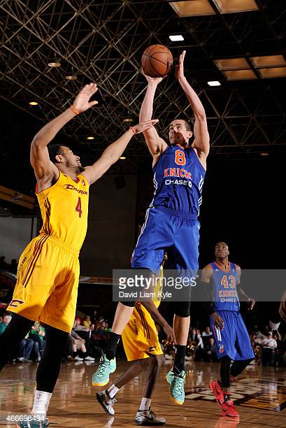 Ben Strong of the Westchester Knicks goes up for the shot against Chris Crawford 0of the Canton Charge at the Canton Memorial Civic Center on March...