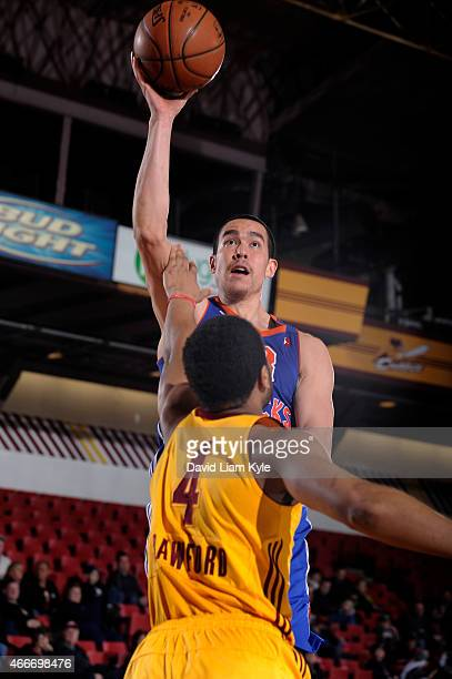 Ben Strong of the Westchester Knicks shoots over Chris Crawford of the Canton Charge at the Canton Memorial Civic Center on March 17 2015 in Canton...