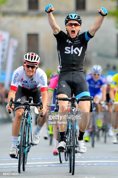 Ben Swift of Great Britain and Team Sky celebrates winning from Michal Kwiatkowski of Poland and Omega Pharma QuickStep third during Stage Five of...