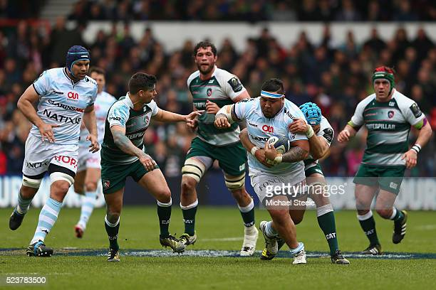 Ben Tameifuna of Racing 92 holds off the challenge of Graham Kitchener of Leicester as Ben Youngs closes in during the European Rugby Champions Cup...