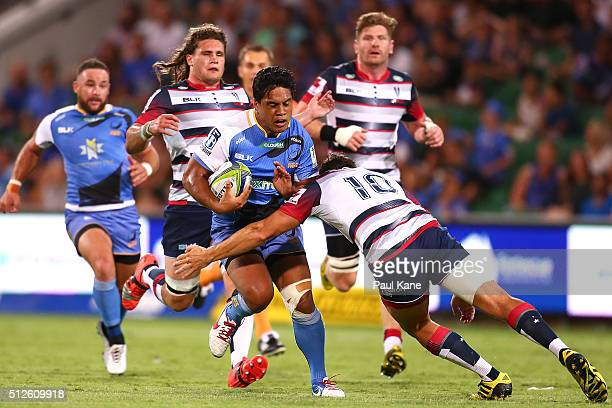 Ben Tapuai of the Force looks to avoid being tackled by Mike Harris of the Rebels during the round one Super Rugby match between the Force and the...