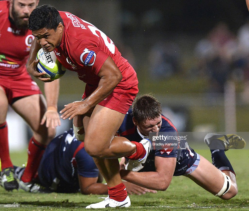 Ben Tapuai of the Reds breaks through the defence during the Super Rugby trial match between the Queensland Reds and the Melbourne Rebels at Ballymore Stadium on February 14, 2014 in Brisbane, Australia.
