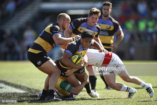 Ben Tapuai of the Spirit is tackled during the NRC Semi Final match between the Sydney Rays and Perth Spirit at Pittwater Park on October 16 2016 in...