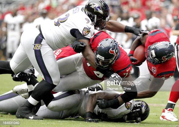 Ben Tate of the Houston Texans is tackled by DeAngelo Tyson of the Baltimore Ravens on October 21 2012 at Reliant Stadium in Houston Texas Texas won...