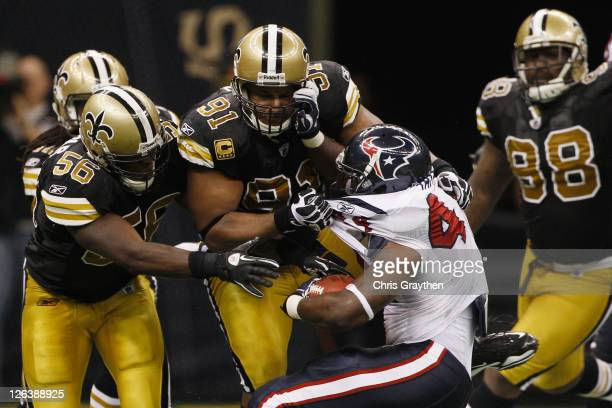 Ben Tate of the Houston Texans is tackled by Will Smith of the New Orleans Saints at the Louisiana Superdome on September 25 2011 in New Orleans...