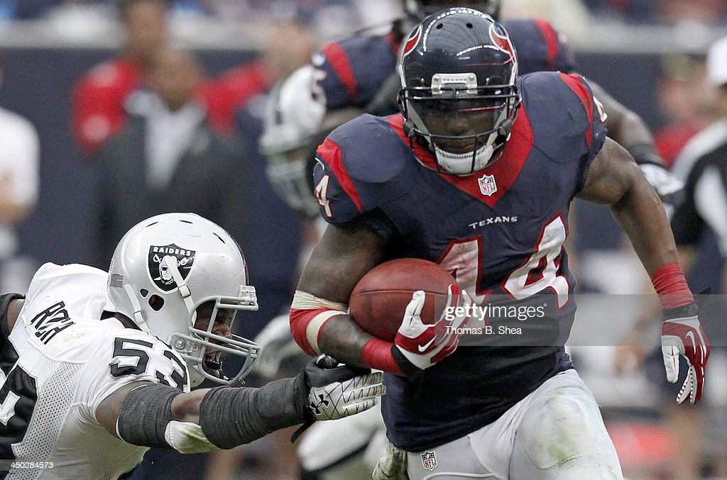 Ben Tate #44 of the Houston Texans rushes past Nick Roach #53 of the Oakland Raiders on November 17, 2013 at Reliant Stadium in Houston, Texas. Raiders won 28 to 23.