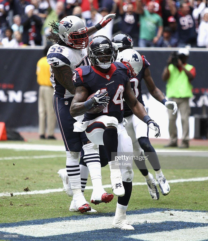 <a gi-track='captionPersonalityLinkClicked' href=/galleries/search?phrase=Ben+Tate&family=editorial&specificpeople=4091148 ng-click='$event.stopPropagation()'>Ben Tate</a> #44 of the Houston Texans scores on a 20 yard run in the second quarter as beats <a gi-track='captionPersonalityLinkClicked' href=/galleries/search?phrase=Brandon+Spikes&family=editorial&specificpeople=2972710 ng-click='$event.stopPropagation()'>Brandon Spikes</a> #55 of the New England Patriots to the endzone at Reliant Stadium on December 1, 2013 in Houston, Texas.