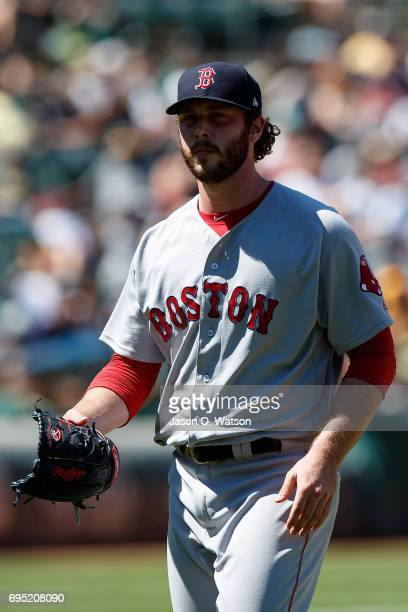 Ben Taylor of the Boston Red Sox returns to the dugout after being relieved against the Oakland Athletics during the fifth inning at the Oakland...