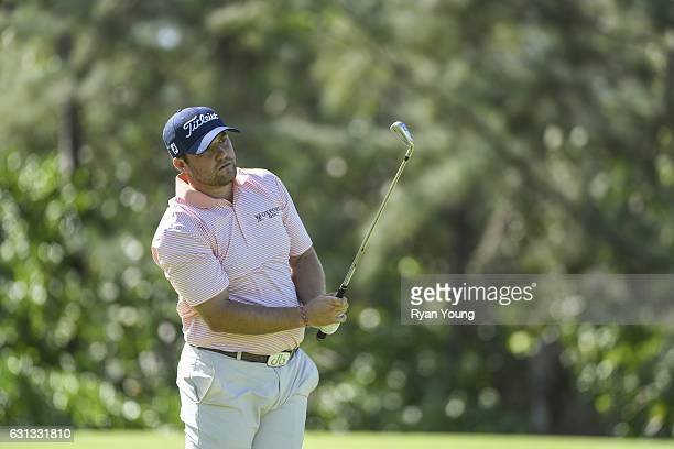 Ben Taylor plays his second shot on the ninth hole during the continuation of the first round of The Bahamas Great Exuma Classic at Sandals Emerald...