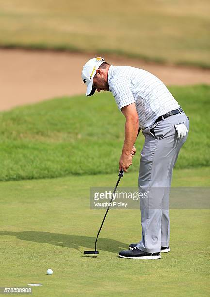Ben Taylor sinks a putt on the fifth hole during the first round of the RBC Canadian Open at Glen Abbey Golf Club on July 21 2016 in Oakville Canada
