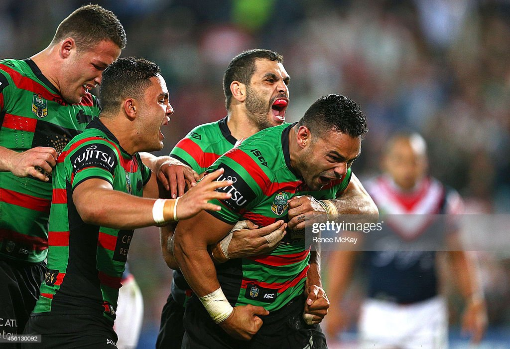 Ben Te'o celebrates his try with Sam Burgess, Dylan Walker and Greg Inglis during the First Preliminary Final match between the South Sydney Rabbitohs and the Sydney Roosters at ANZ Stadium on September 26, 2014 in Sydney, Australia.