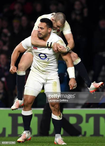 Ben Te'o of England celebrates scoring his side's first try with his team mate Mike Brown during the RBS Six Nations match between England and France...