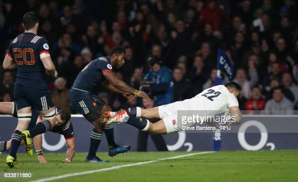 Ben Te'o of England dives over to score his team's first try during the RBS Six Nations match between England and France at Twickenham Stadium on...