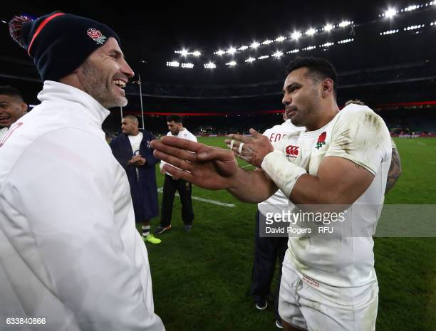 Ben Te'o of England speaks with Paul Gustard the England defense coach following their team's 1916 victory during the RBS Six Nations match between...