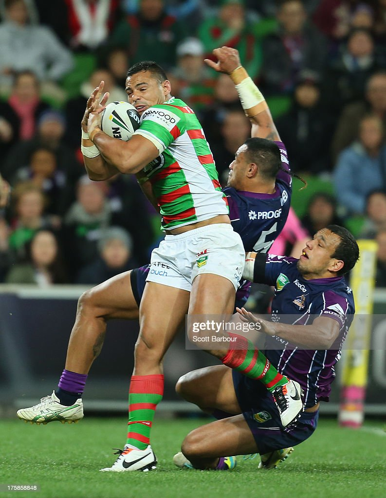 Ben Teo of the Rabbitohs catches a high ball and scores his teams first try of the match during the round 22 NRL match between the Melbourne Storm and the South Sydney Rabbitohs at AAMI Park on August 9, 2013 in Melbourne, Australia.