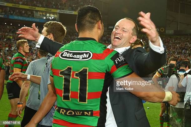 Ben Te'o of the Rabitohs celebrates with Rabbitohs coach Michael Maguire during the 2014 NRL Grand Final match between the South Sydney Rabbitohs and...