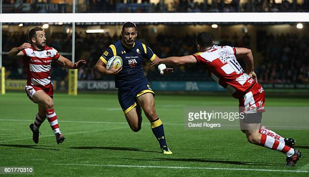 Ben Te'o of Worcester holds off Greig Laidlaw and Tom Marshall to score the first try during the Aviva Premiership match between Worcester Warriors...