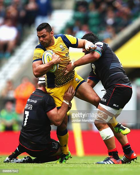 Ben Te'o of Worcester Warriors is tackled by Schalk Burger and Juan Figallo of Saracens during the Aviva Premiership match between Saracens and...