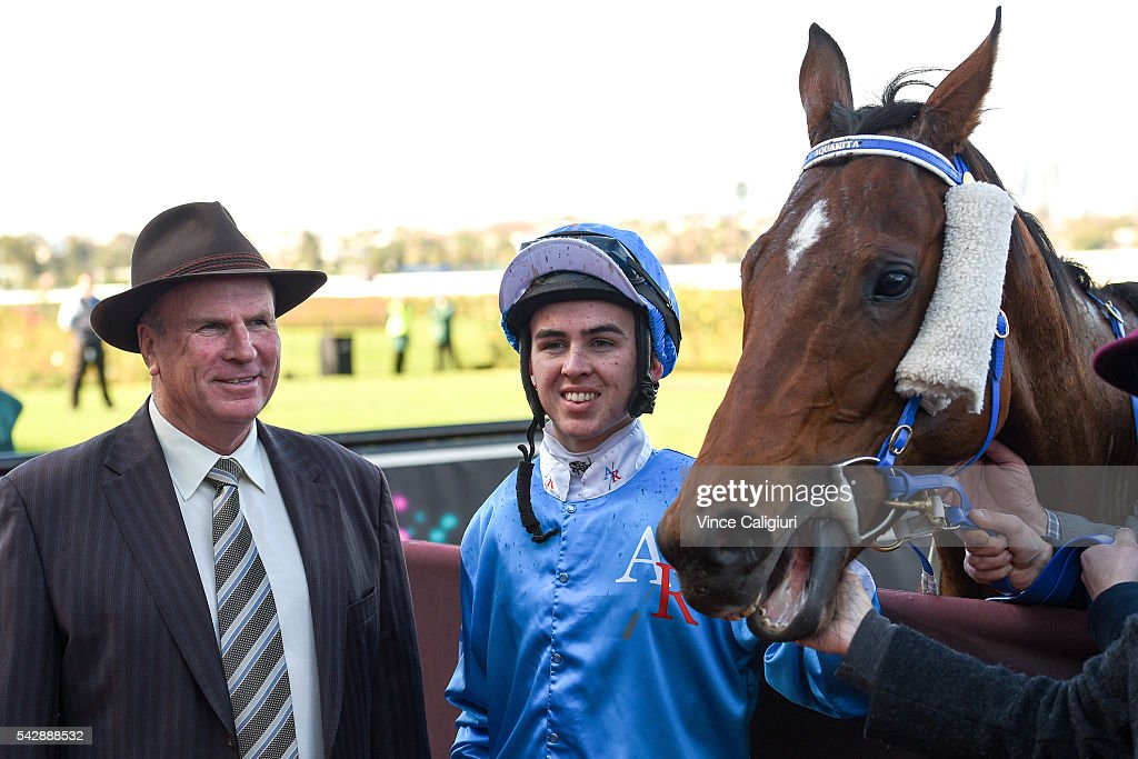 Ben Thompson poses with trainer Robert Smerdon after riding Iggimacool to win Race 2, during Melbourne Racing at Flemington Racecourse on June 25, 2016 in Melbourne, Australia.