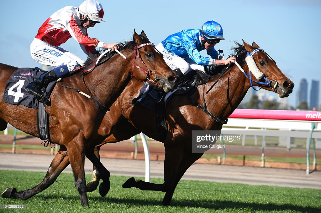 Ben Thompson riding Iggimacool defeats Michael Dee riding Telopea in Race 2, during Melbourne Racing at Flemington Racecourse on June 25, 2016 in Melbourne, Australia.