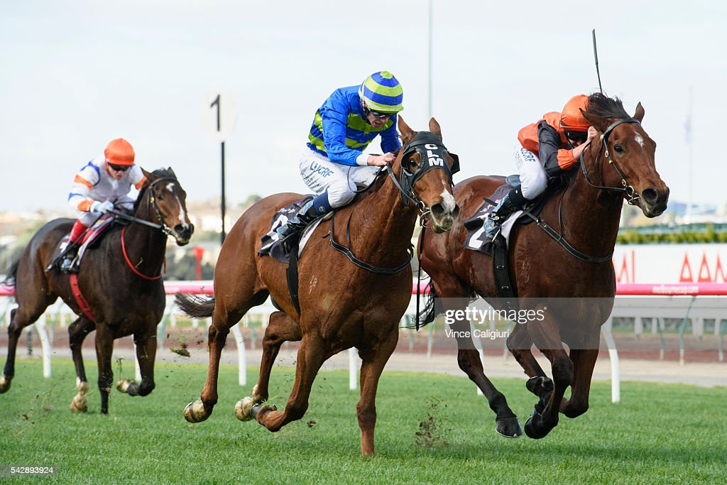 Ben Thompson riding Pin Your Hopes defeats Michael Dee riding Name the Day in Race 3, during Melbourne Racing at Flemington Racecourse on June 25, 2016 in Melbourne, Australia.