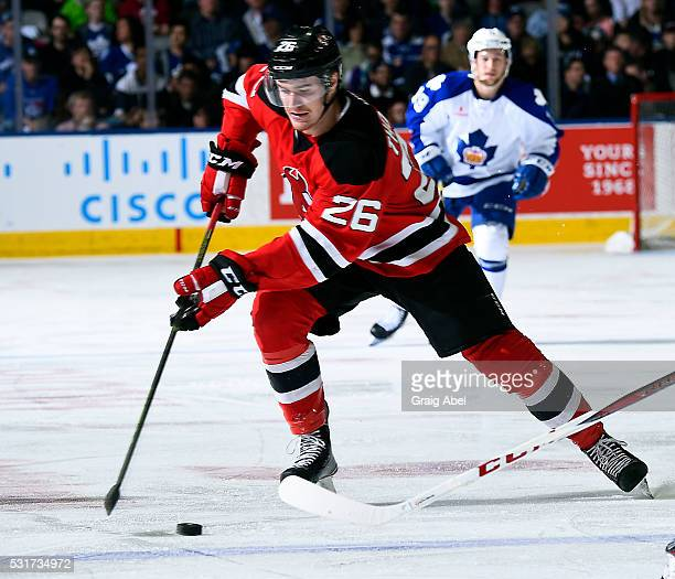 Ben Thomson of the Albany Devils carries the puck up ice against the Toronto Marlies during AHL playoff game action on May 14 2016 at Ricoh Coliseum...