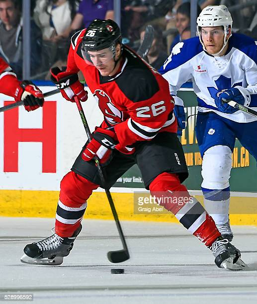 Ben Thomson of the Albany Devils controls the puck against the Toronto Marlies during 2nd round AHL playoff game action on May 4 2016 at Ricoh...
