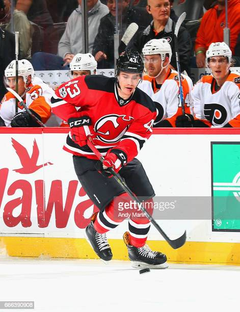 Ben Thomson of the New Jersey Devils playing in his first NHL game plays the puck in the first period against the Philadelphia Flyers during the game...