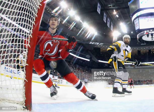 Ben Thomson of the New Jersey Devils skates against the Pittsburgh Penguins at the Prudential Center on April 6 2017 in Newark New Jersey The...