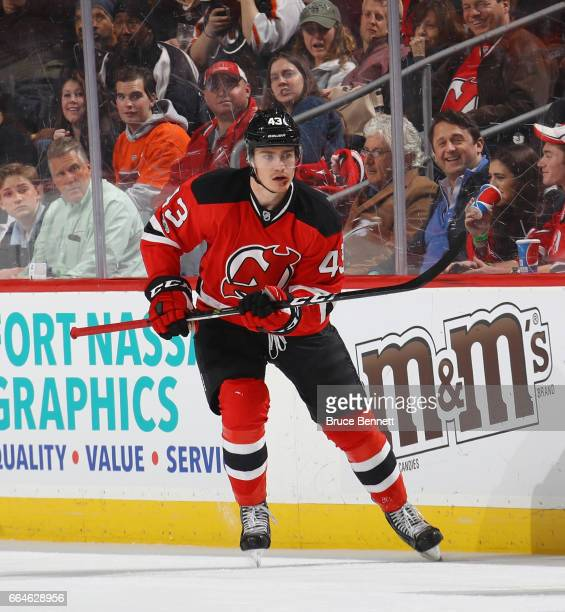 Ben Thomson of the New Jersey Devils skates in his first NHL game against the Philadelphia Flyers at the Prudential Center on April 4 2017 in Newark...