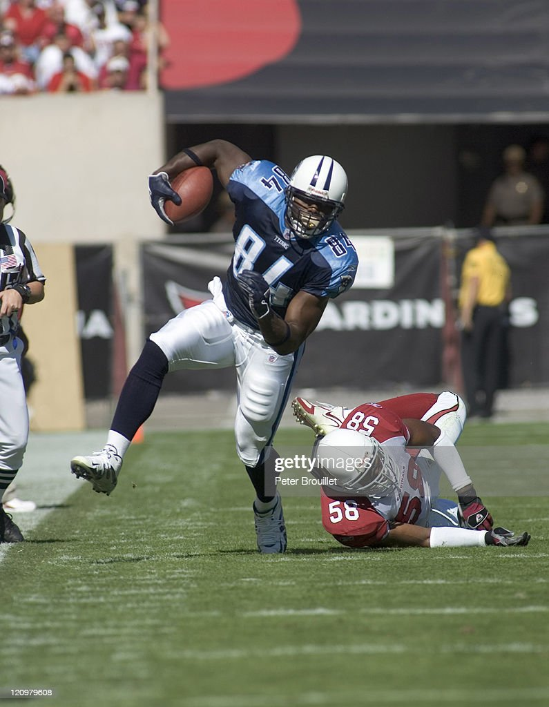 Ben Troupe tight end for the Tennessee Titans breaks free after a catch and heads upfield in a game at Sun Devil Stadium in Tempe, Arizona on October 23, 2005.