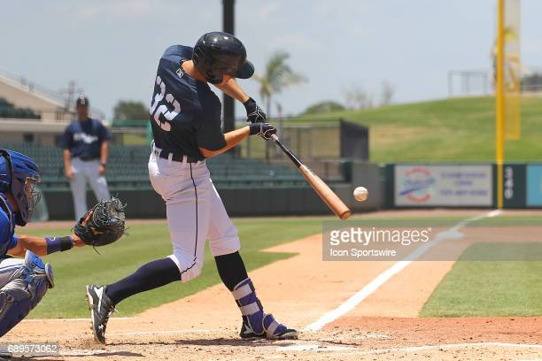 Ben Verlander of the Flying Tigers puts the bat on the ball and hits a single during the Florida State League game between the Dunedin Blue Jays and...