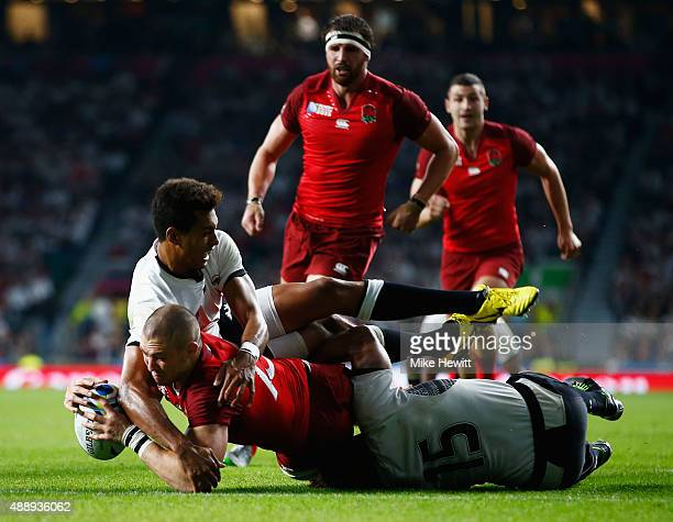 Ben Volavola and Metuisela Talebula of Fiji fail to stop Mike Brown of England scoring their third try during the 2015 Rugby World Cup Pool A match...