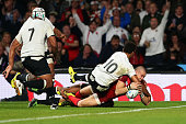 Ben Volavola of Fiji fails to stop Mike Brown of England scoring their third try during the 2015 Rugby World Cup Pool A match between England and...