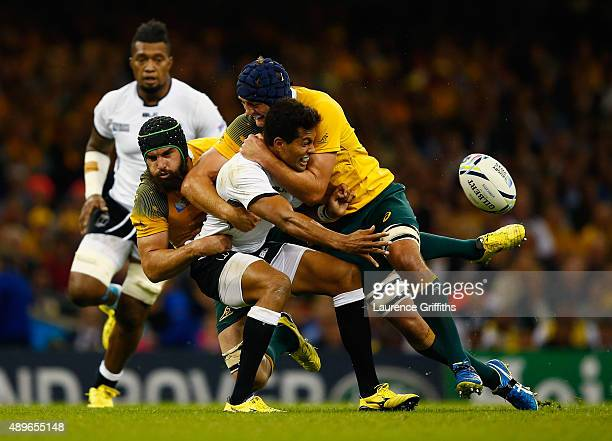 Ben Volavola of Fiji offloads in the tackle during the 2015 Rugby World Cup Pool A match between Australia and Fiji at the Millennium Stadium on...