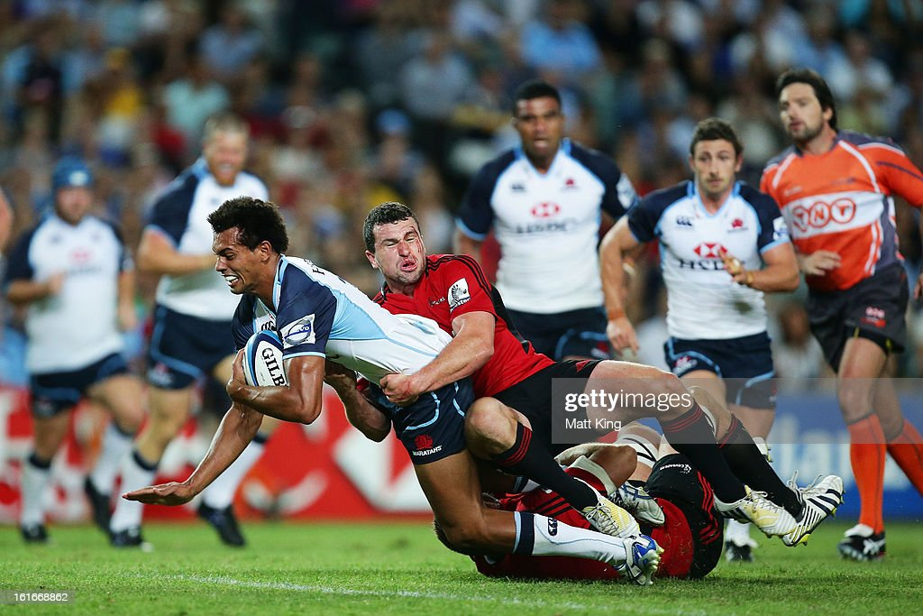 Ben Volavola of the Waratahs is tackled during the Super Rugby trial match between the Waratahs and the Crusaders at Allianz Stadium on February 14, 2013 in Sydney, Australia.