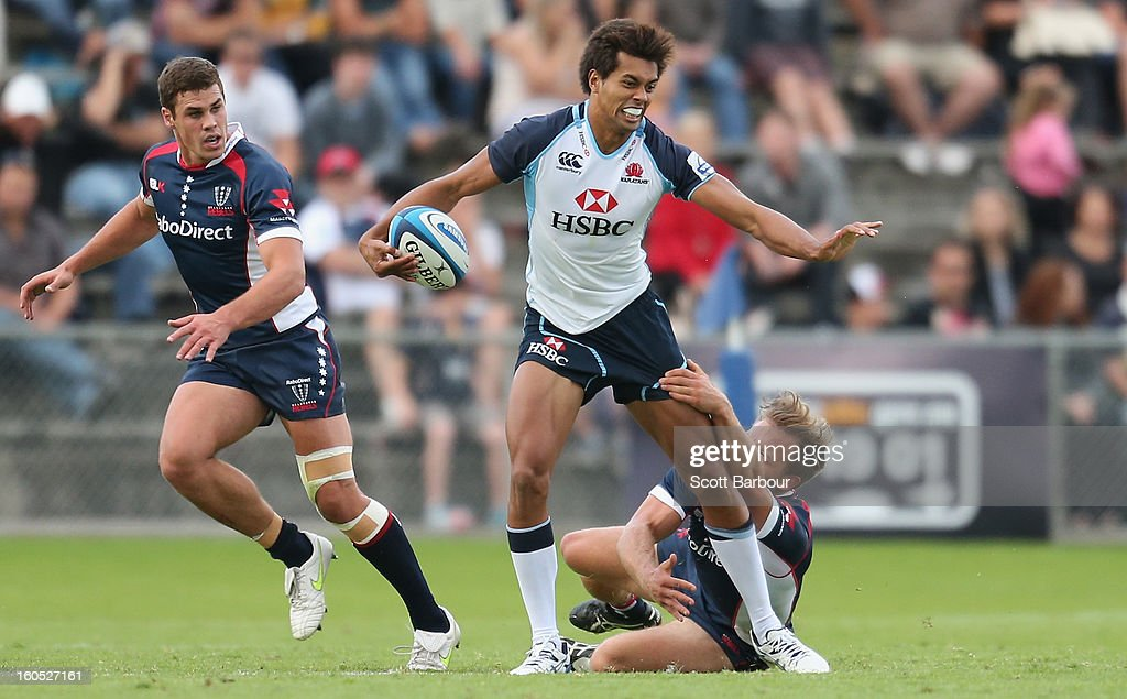 Ben Volavola of the Waratahs runs with the ball during the Super Rugby trial match between the Waratahs and the Rebels at North Hobart Stadium on February 2, 2013 in Hobart, Australia.