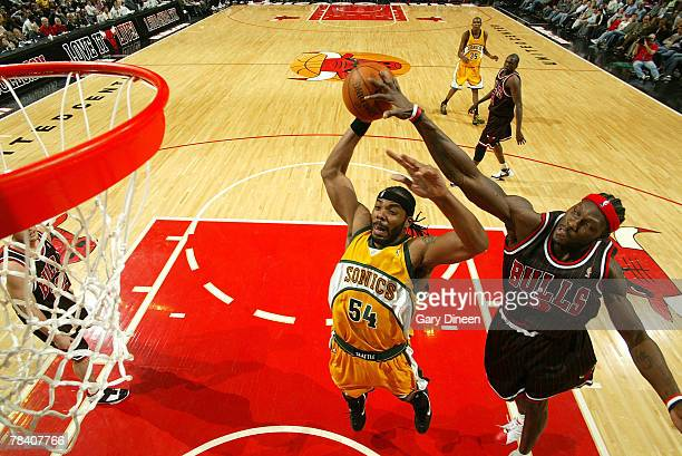 Ben Wallace of the Chicago Bulls blocks a shot by Chris Wilcox of the Seattle SuperSonics on December 11 2007 at the United Center in Chicago...