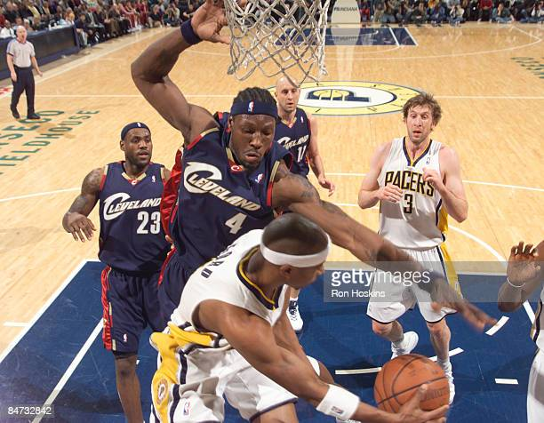 Ben Wallace of the Cleveland Cavaliers battles T J Ford of the Indiana Pacers at Conseco Fieldhouse on February 10 2009 in Indianapolis Indiana The...