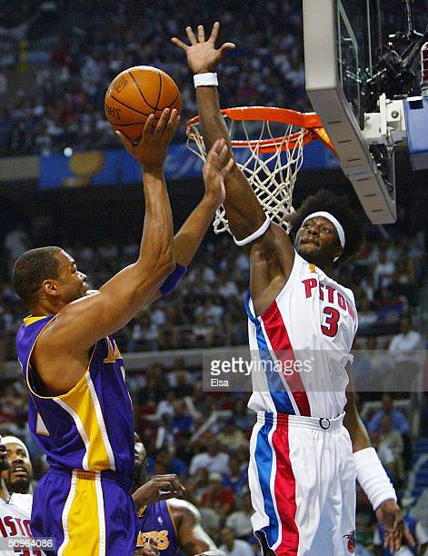 Ben Wallace of the Detroit Pistons attempts to block a shot by Devean George of the Los Angeles Lakers during the second quarter in Game five of the...