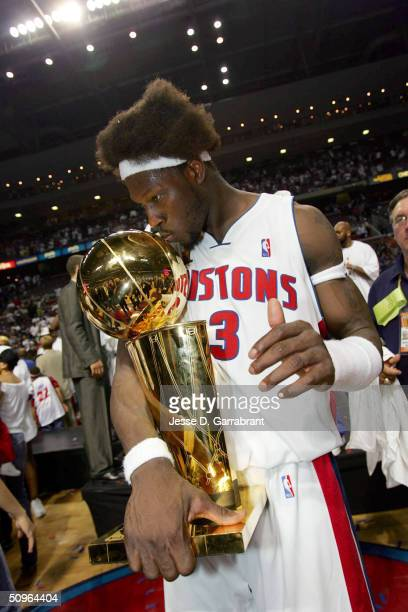 Ben Wallace of the Detroit Pistons celebrates after winning the Championship as he kiss the Larry O'Brien trophy in Game five of the 2004 NBA Finals...