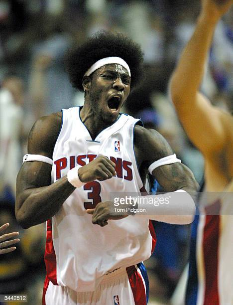 Ben Wallace of the Detroit Pistons celebrates during game one of round one of the 2004 NBA Eastern Conference Playoffs April 18 2004 at the Palace of...